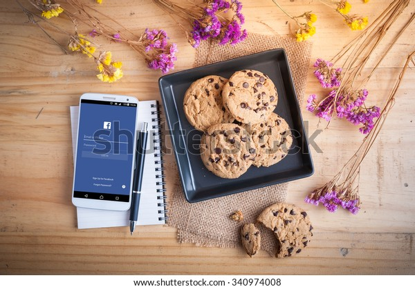 CHIANG MAI, THAILAND - NOVEMBER 16,2015: Cookies with Facebook app showing on Android smart phone. Facebook is the most popular social networking site in the world.