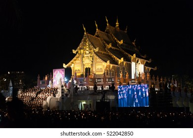 Chiang Mai, Thailand - November 2, 2016: Thai mourners hold candles and pray for the late King Bhumibol Adulyadej at Royal Park Rajapruek, Chiang Mai, Thailand on November 2, 2016.