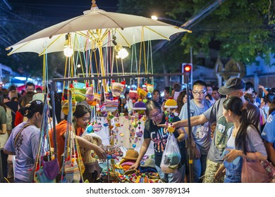 Chiang Mai, Thailand - November 29, 2015: Tourists are shopping in night market, located in Chiang Mai, Thailand.