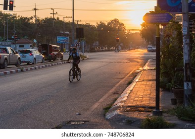 "CHIANG MAI, THAILAND -November 5, 2017: unrecognizable people on street with light traffic close to ""tonpayom market"" on Suthep road near Chiang Mai University on morning time Chiang Mai,Thailand."