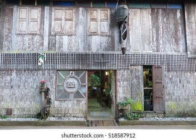 CHIANG MAI, THAILAND - NOVEMBER 9, 2016 : Old wooden house exterior architecture, old wood wall texture at Mae Kampong Village, Chiang Mai, Thailand