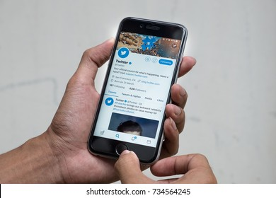 CHIANG MAI, THAILAND - OCT 03, 2017: Man holding a brand new Apple iPhone with Twitter account on the screen. Twitter is a social media online service for microblogging and networking communication.