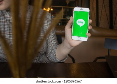 CHIANG MAI, THAILAND - OCT 08,2018: Woman holding iphone 6s with LINE apps on screen. LINE is a new communication app which allows you to make free voice calls and send free messages.
