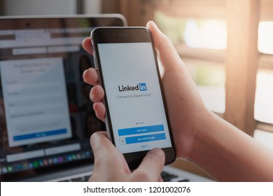 CHIANG MAI, THAILAND - OCT 12 ,2018: Woman holding iphone 6s mobile phone with Linkedin application on the screen. Linkedin is a business and employment oriented social networking service.