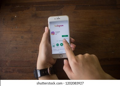 CHIANG MAI, THAILAND - OCT 15, 2018: A woman hand holding iphone 6s with new logo of instagram application. Instagram is largest and most popular photograph social networking.