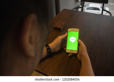 CHIANG MAI, THAILAND - OCT 15,2018: Woman holding iphone 6s with LINE apps on screen. LINE is a new communication app which allows you to make free voice calls and send free messages.