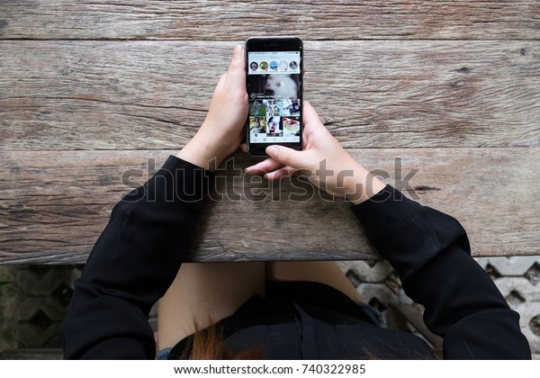 CHIANG MAI, THAILAND - OCT 17, 2017: A beautiful woman hand holding iphone with new logo of instagram application. Instagram is largest and most popular photograph social networking.