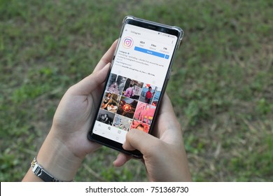 CHIANG MAI, THAILAND - OCT 21,2017: Woman holding Smartphone and using Instagram application on the screen.Instagram is largest and most popular photography social network.
