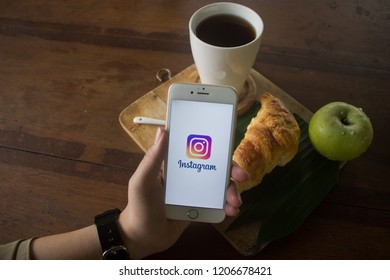 CHIANG MAI, THAILAND - OCT 22, 2018: A woman hand holding iphone 6s with new logo of instagram application. Instagram is largest and most popular photograph social networking.