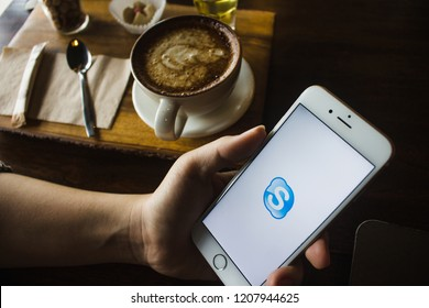 CHIANG MAI, THAILAND - OCT 22,2018: Woman holding iPhone 6s with skype apps. Skype is part of Microsoft, can make video, audio calls, chat messages and do much more using Skype.