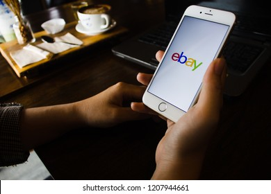 CHIANG MAI, THAILAND - OCT 22,2018: Woman hands holding iPhone 6s with eBay apps on the screen. eBay is one of the most popular ways to buy and sell goods and services on the internet.