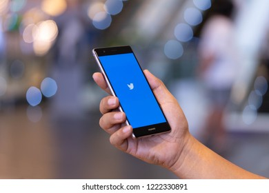 CHIANG MAI, THAILAND - Oct. 28,2018: Man holding HUAWEI with Twitter app on the screen.Twitter is an online news and social networking service where users post and interact with messages.