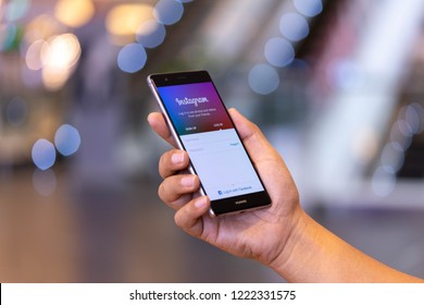 CHIANG MAI, THAILAND - Oct. 28,2018: Man holding HUAWEI with Instagram application on the screen. Instagram is a popular online social networking service.