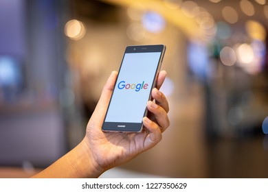 CHIANG MAI, THAILAND - Oct. 28,2018: Man holding HUAWEI with google search on screen. Google is the biggest Internet search engine and online advertising technologies in the world.