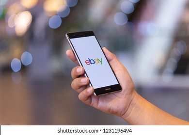 CHIANG MAI, THAILAND - Oct. 28,2018: Man holding HUAWEI with eBay apps on the screen. eBay is one of the most popular ways to buy and sell goods and services on the internet.