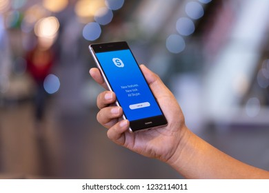 CHIANG MAI, THAILAND - Oct. 28,2018: Man holding HUAWEI with skype apps. Skype is part of Microsoft, can make video, audio calls, chat messages and do much more using Skype.