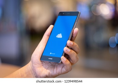CHIANG MAI, THAILAND - Oct. 28,2018: Man holding HUAWEI with OneDrive on screen. Microsoft OneDrive is a file hosting service that allows users to sync files.