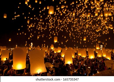 CHIANG MAI, THAILAND -OCT 29: A lot of people are launching sky lanterns in Loy Krathong and Yi Peng Festival. October 29, 2011 at Tu-dong-ka-sa-than,Maejo, Chiang Mai, Thailand