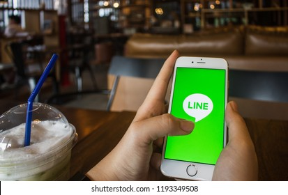 CHIANG MAI, THAILAND - OCT 3,2018: Woman holding iphone 6s with LINE apps on screen. LINE is a new communication app which allows you to make free voice calls and send free messages.