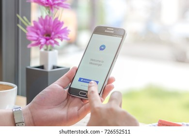 Chiang Mai, Thailand - October 03, 2017: Samsung Galaxy S6 smartphone launches facebook messenger application on the desk screen at the coffee shop.