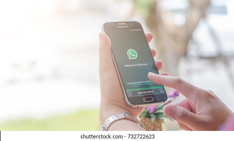Chiang Mai, Thailand - October 12, 2017: Samsung Galaxy S6 smartphone launches whatsapp application on the desk screen at the coffee shop.