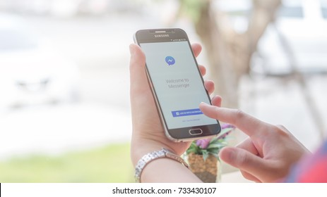 Chiang Mai, Thailand - October 13, 2017: Samsung Galaxy S6 smartphone launches facebook messenger application on the desk screen at the coffee shop.