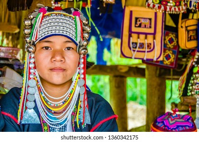 Chiang Mai, Thailand -  October 14, 2011 : Unidentified Akha tribe woman with traditional clothes and silver jewelery in hill tribe minority village and marketin Thailand.