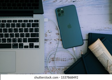 Chiang Mai, Thailand - October 18, 2019: Apple iPhone 11 Pro Max make a connection with a laptop. iPhone was created and developed by the Apple inc.