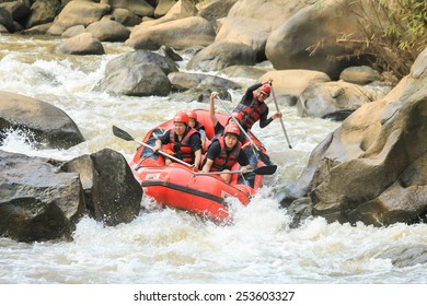 CHIANG MAI, THAILAND - OCTOBER 20 : White water rafting on the rapids of river Maetang on OCTOBER 20, 2014 in Chiang Mai, Thailand.  Maetang river is one of the most dangerous rivers of Thailand.