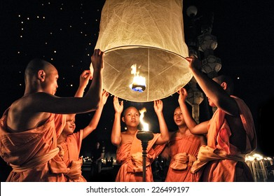 CHIANG MAI THAILAND - OCTOBER 25 : The Floating Lanterns Tudong - Khasathan festival. Novices lights floating lanterns made of paper annually at the Sansai. on Oct. 25, 2014 in Chiang Mai, Thailand.