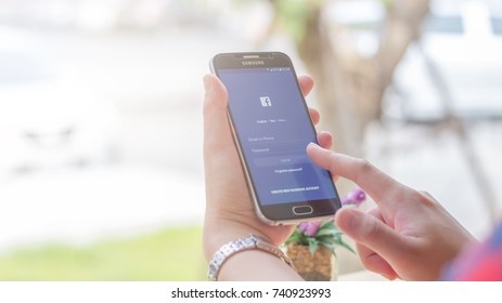 Chiang Mai, Thailand - October 25, 2017: Samsung Galaxy S6 smartphone launches facebook application on the desk screen at the coffee shop.