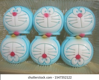 Chiang Mai /Thailand - October 26 2019; Doraemon cartoon coconut milk jelly dessert in a plastic tray .They're deliciously and interesting snacks that have a sweet and fragrant flavor.