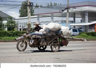 CHIANG MAI, THAILAND -OCTOBER 6 2017:   Old Man and Old Honda Motercycle. Photo at road no.121 about 8 km from downtown Chiangmai, thailand.
