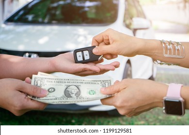 Chiang mai, Thailand - October 7,2018: Young girl in a Car Rental, service test drive concept, auto business, car sale, deal, gesture and people concept - close up of girl hand.