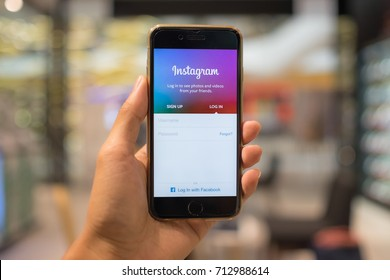 CHIANG MAI, THAILAND - SEP 07, 2017: A man hand holding iphone with login screen of instagram application. Instagram is largest and most popular photograph social networking.
