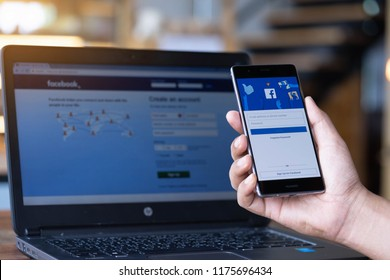 CHIANG MAI, THAILAND - Sep. 08,2018: Man hands holding HUAWEI with facebook app on the screen. Facebook is a popular free social media are used for information sharing and networking.