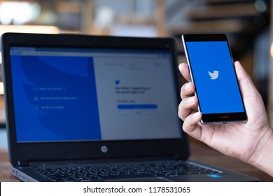 CHIANG MAI, THAILAND - Sep. 08,2018: Man hand holding HUAWEI with Twitter app on the screen.Twitter is an online news and social networking service where users post and interact with messages.