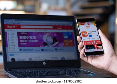 CHIANG MAI, THAILAND - Sep. 08,2018: Man hands holding HUAWEI with taobao apps on screen.Taobao's a Chinese online shopping is a subsidiary of Alibaba Group one of the world's biggest e-commerce web.