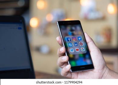 CHIANG MAI, THAILAND - Sep. 08,2018: Man holding HUAWEI with icons of social media on the screen. Social media are most popular tool. Smartphone lifestyle. Starting social media app.