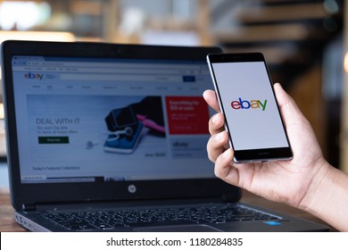 CHIANG MAI, THAILAND - Sep. 08,2018: Man hands holding HUAWEI with eBay apps on the screen. eBay is one of the most popular ways to buy and sell goods and services on the internet.