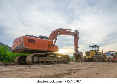 CHIANG MAI, THAILAND - SEP 15,2017: Hitachi Tractors stop working in the evening after working with nature location background.