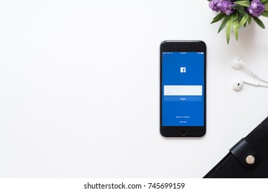 CHIANG MAI, THAILAND - Sep 23, 2017: The Facebook iOS application is launching on iPhone. The login screen is showing. Facebook is the social network application that connects people together online.