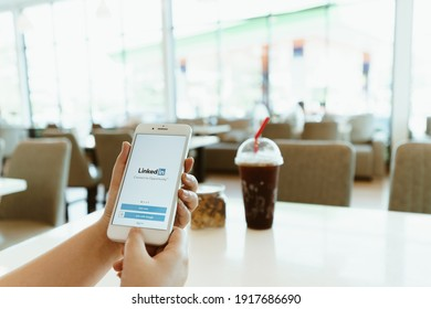 CHIANG MAI, THAILAND - Sep. 26,2020: woman holds iPhone with LinkedIn application on the screen.LinkedIn is a photo-sharing app for smartphones.
