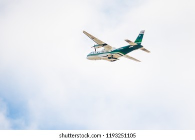 """CHIANG MAI, THAILAND - SEP 30: 2018 The plane of """"Royal Rainmaking Project"""" run by the Department of Agriculture Aviation in Thailand flying in sky on September 30, 2018 in Chiang Mai, Thailand."""