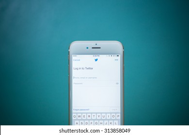 CHIANG MAI, THAILAND - SEPTEMBER 02, 2015:  Twitter application on Apple iPhone 6 blue background. Twitter is largest and most popular social networking site in the world.