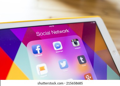 CHIANG MAI, THAILAND - SEPTEMBER 07, 2014: All of popular social media icons on tablet device screen wood background.