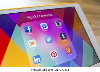 CHIANG MAI, THAILAND - SEPTEMBER 07, 2014: All of popular social media icons on Apple new iPad Air device screen wood background.