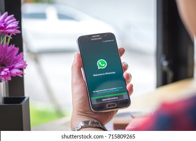 Chiang Mai, Thailand - September 15, 2017: Samsung Galaxy S6 smartphone launches whatsapp application on the desk screen at the coffee shop.