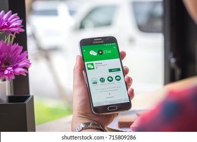 Chiang Mai, Thailand - September 15, 2017: Samsung Galaxy S6 smartphone launches wechat application on the desk screen at the coffee shop.