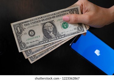 Chiang mai, Thailand - September 15,2018: The Women Shopping in US Dollar paying in cash or Using credit card visa, mastercard for shopping.